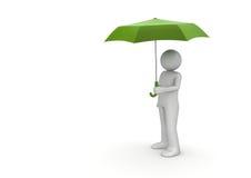 Mann unter grünem Regenschirm Stockfoto