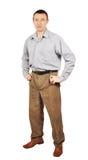 Mann von mittlerem Alter kleidete in der Hose und im grauen Hemd an Lizenzfreies Stockbild