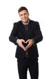 Mann zeigt ein Liebeszeichen durch seine Hände Stockbilder