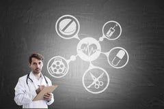 Manndoktor und medizinische Ikonen Lizenzfreie Stockfotos