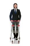 Manneinkaufen mit Supermarktkorbwarenkorb Lizenzfreies Stockbild