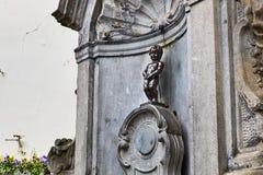 Manneken Pis雕象在布鲁塞尔 库存图片