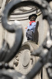 Manneken Pis with beret and baguette Stock Photography