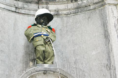 Manneken Pis at Brussels, Belgium. Famous Manneken Pis with military dress at Brussels, Belgium stock image
