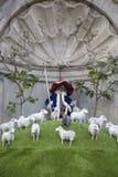 Manneken Pis is dressed in costume shepherd sheep royalty free stock photography