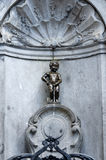 Manneken Pis (Little man Pee), a Famous bronze sculpture in Brus Stock Images