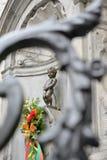 Manneken Pis mit Blumen Lizenzfreies Stockbild