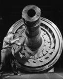 Mannelijke arbeider met massieve machines (Alle afgeschilderde personen leven niet langer en geen landgoed bestaat Leveranciersga Royalty-vrije Stock Foto's