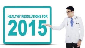 Mannelijke arts met gezonde resoluties Stock Foto's