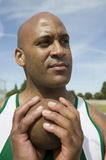 Mannelijke Atleet With Shot Put Stock Foto