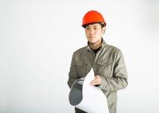 Mannelijke bouwvakker en het schetsen van blauwdrukken Royalty-vrije Stock Foto's