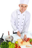 Mannelijke chef-kok die wat voedsel voorbereiden Royalty-vrije Stock Afbeeldingen