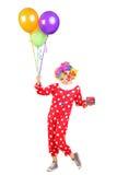 Mannelijke clown met een bos van ballons Royalty-vrije Stock Foto's