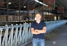 Mannelijke eigenaar van een ranch in een landbouwbedrijf Stock Foto's