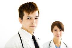 mannelijke en vrouwelijke artsen die zich verenigen Stock Fotografie