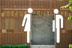 Mannelijke en vrouwelijke pictogrammen stock afbeeldingen