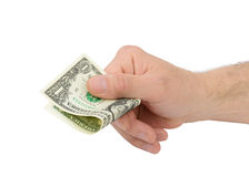 Mannelijke hand die één die dollarrekening houdt op witte achtergrond wordt geïsoleerd Stock Foto