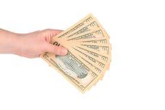 Mannelijke hand die Amerikaanse dollar-Rekeningen houden royalty-vrije stock afbeeldingen