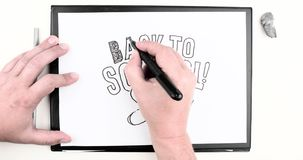 Mannelijke hand die de tekst schrijven: 'Terug naar School ' Geschoten op Canon 5D Mark II met Eerste l-Lenzen vector illustratie