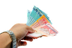 Mannelijke hand die geld geven Stock Afbeeldingen