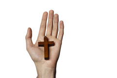 Mannelijke hand die houten kruis houden Stock Afbeeldingen