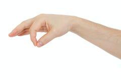 Mannelijke hand die wat dun voorwerp houdt Royalty-vrije Stock Foto's