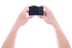 Mannelijke handen die compacte digitale camera met lege het schermisol houden stock fotografie