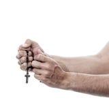 Mannelijke handen die met rozentuin bidden stock foto's