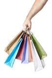 Mannelijke handholding het winkelen zakken die op wit worden geïsoleerd stock afbeeldingen