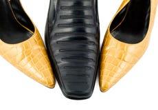 Mannelijke schoen en vrouwelijke leegloper Stock Foto