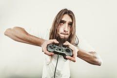 Mannelijke spelernadruk op spelspelen Royalty-vrije Stock Fotografie