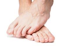 Mannelijke voeten over andere royalty-vrije stock fotografie