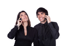 Mannen en vrouw die op de telefoon spreken Royalty-vrije Stock Afbeelding