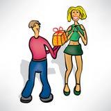 Mannen ger flickan en gåva Arkivbild