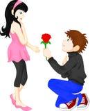 Mannen ger röda blommakvinnor Arkivbild