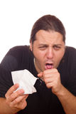 Mannen har en förkylning och en hosta arkivfoto