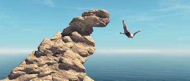 Mannen hoppar in i havet från en klippa royaltyfri fotografi