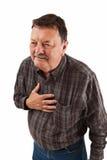 Mannen i hans sixties som har bröstkorgen, smärtar Fotografering för Bildbyråer