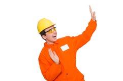 Mannen i orange overaller som isoleras på vit Royaltyfri Bild