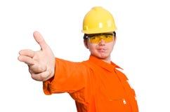 Mannen i orange overaller som isoleras på vit Fotografering för Bildbyråer