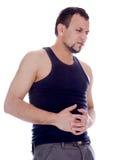 Mannen i ruskigt smärtar i mage Fotografering för Bildbyråer