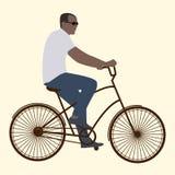 Mannen i svarta exponeringsglas som rider en cykel, lägenhetstil Arkivfoton