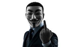 Mannen maskerade den anonyma gruppen som pekar fingerkonturståenden royaltyfri fotografi