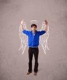 mannen med den illustrerade ängeln påskyndar på grungy bakgrund Arkivfoto
