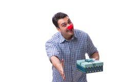 Mannen med ett roligt innehav för röd näsa per gåva för gåva för shoppingpåse är Royaltyfria Foton