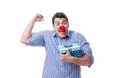 Mannen med ett roligt innehav för röd näsa per gåva för gåva för shoppingpåse är Royaltyfria Bilder