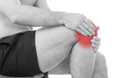 Mannen med knäet smärtar fotografering för bildbyråer