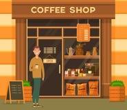 Mannen med koppen kaffe nära kafeteria ställer ut royaltyfri illustrationer