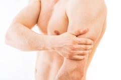 Mannen med triceps smärtar Arkivfoton