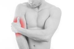 Mannen med triceps smärtar Royaltyfria Foton